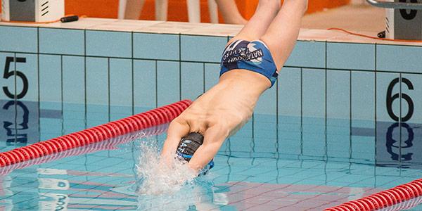 man dicing into swimming pool